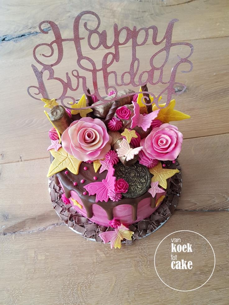 Verjaardagstaart roze goud en heel veel chocolade